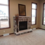 Stone Accented Fireplace (Geranium)